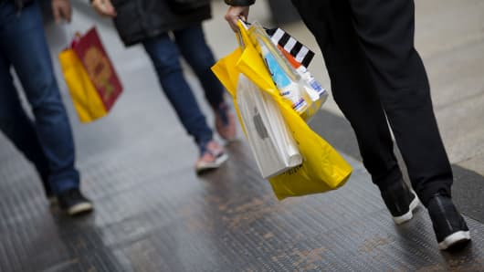 A pedestrian carries shopping bags while walking in the Soho neighborhood of New York.