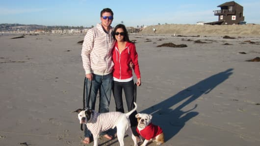 Nichole Mayer with her husband, Hunter Bodycott, and their two bulldogs Bella and Winston.