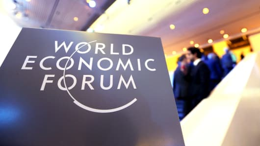 A logo sits on a sign at the World Economic Forum in Davos, Switzerland, on Thursday, Jan. 23, 2014.