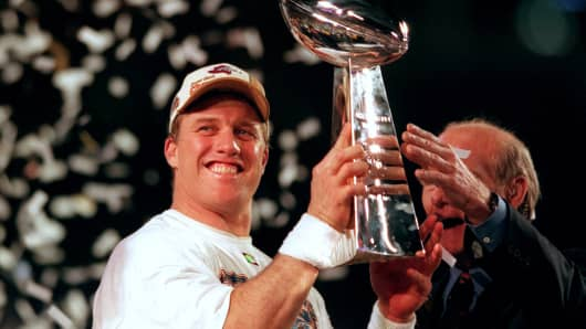 Former Denver quarterback John Elway with the Vince Lombardi trophy after the Broncos won Super Bowl XXXIII in 1999.
