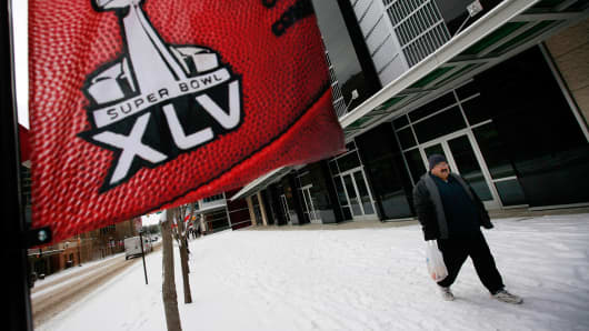 A man walks along a snow-covered sidewalk in Fort Worth, Texas, in February 2011, days before the Super Bowl.