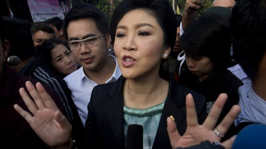 Thai Prime Minister Yingluck Shinawatra answers questions from the press after voting at a polling station in Bangkok on February 2, 2014.