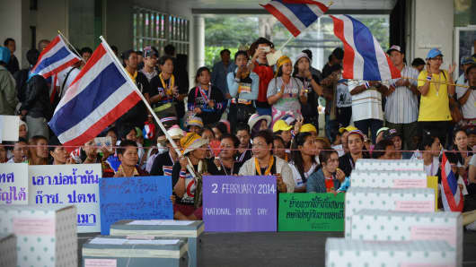 Anti-government protesters gather in front of ballot boxes in preventing voting at a polling station during Thailand's general election on February 2, 2014 in Bangkok, Thailand.