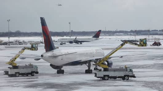 File photo of planes being de-iced at New York's LaGuardia.