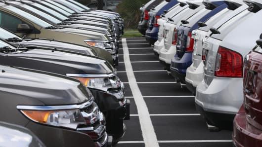 Ford vehicles are seen on the sales lot at a Ford AutoNation car dealership in North Miami, Florida.