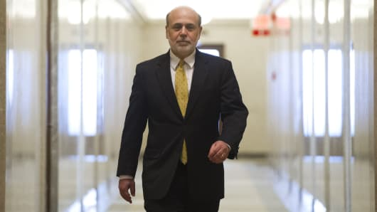 Ben Bernanke, chairman of the Federal Reserve, walks down a hallway to an elevator as he leaves his office on his last day as chairman, at the Federal Reserve in Washington, DC, January 31, 2014.