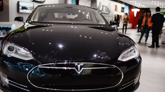 A Model S sedan is displayed in the Tesla showroom at Parkview Green Shopping Mall Beijing, China.