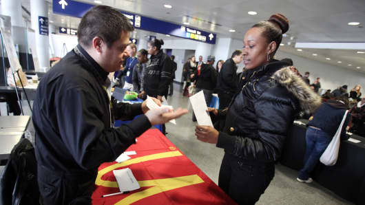 A job seeker, right, talks with a McDonald's representative at a job fair for concession employment opportunities in International Terminal 5 in connection to the redevelopment of the international terminal at O'Hare International Airport in Chicago.