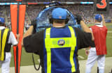 Members of the CBS Sports team work along the sidelines during an NFL game at Ford Field on August 27, 2011 in Detroit, Michigan.