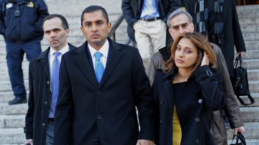 Mathew Martoma, a former SAC Capital Advisors LP fund manager, center, exits federal court with his wife Rosemary Martoma, right, and attorney Roberto Braceras in New York, on Thursday, Feb. 6, 2014.