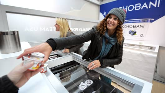 Snowboarder Lindsey Jacobellis hands out Chobani at the 2014 Sochi Winter Olympic Countdown in New York's Times Square on Oct. 29, 2013.