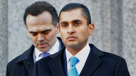 Mathew Martoma, right, exits federal court with his attorney Roberto Braceras in New York, on Thursday, Feb. 6, 2014.
