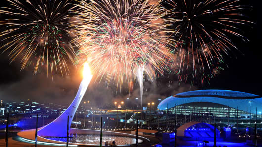Fireworks light the sky over the Fisht Olympic Stadium as the Olympic flame is lit at the end of the Opening Ceremony of the 2014 Sochi Winter Olympics on February 7, 2014 in Sochi.
