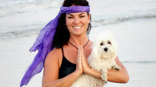 Suzi Teitelman of Doga Dog often teaches her dogs classes on the beach in Jacksonville Beach, Florida