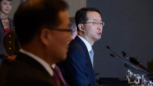 Asiana Airlines CEO Kim Soo Cheon, right, speaks in Seoul on Monday.