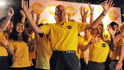 Scoot's chief executive Campbell Wilson celebrates at the unveiling of the new low-cost carrier in Singapore on November 1, 2011.