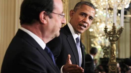 President Obama speaks as French President Francois Hollande looks on during a White House news conference, Feb. 11, 2014.