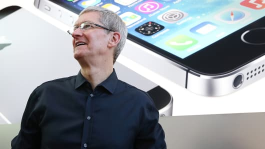 Apple CEO Tim Cook looks on at an Apple Store on September 20, 2013 in Palo Alto, California.