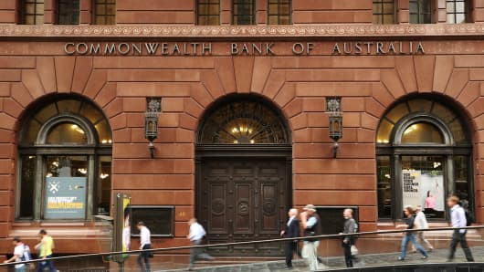 Pedestrians walk past the Commonwealth Bank of Australia (CBA) branch at Martin Place in Sydney, Australia, on Monday, Feb. 10, 2014.