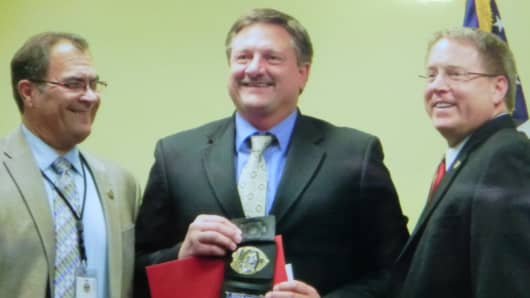 DEA agent Paul Schmidt (center) receives honors for his work.