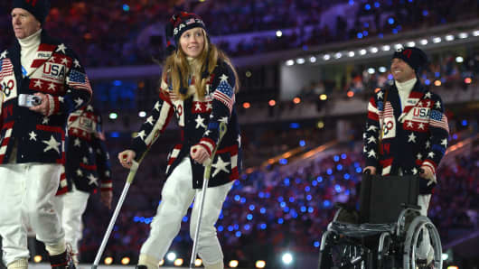 U.S. skier Heidi Kloser, who was injured during qualifications, parades with her delegation during the Opening Ceremony of the Sochi Winter Olympics.
