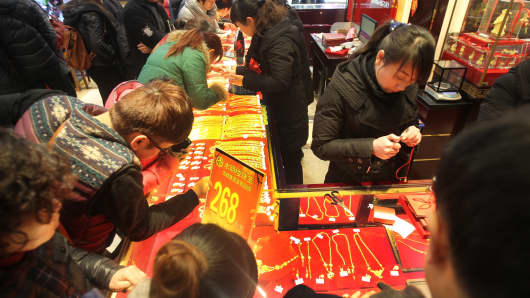 Customers purchase gold products at a gold shop on January 19, 2014 in Nantong, China.