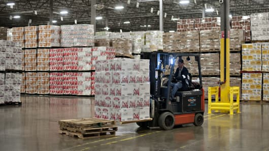 A forklift operator moves a stack of Diageo Plc's Smirnoff brand vodka in a distribution warehouse in Bolingbrook, Illinois.