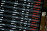 Canceled flights are shown at Raleigh-Durham International Airport on Wednesday in Morrisville, N.C.