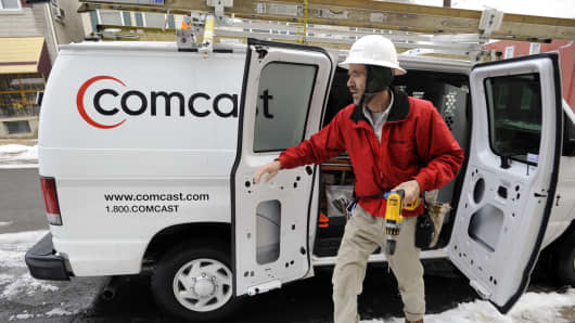 A Comcast Corp. field service technician, arrives to install cable service at a residence in Reading, Pennsylvania.