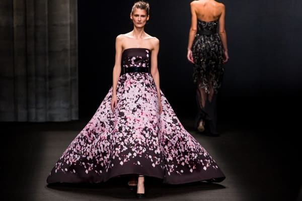 A model walks the runway during Monique Lhuillier fashion show at MBFW Fall 2014 in New York.