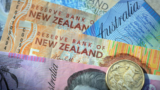 Currency from Australia and New Zealand is arranged for a photograph.