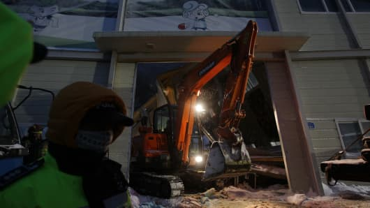 Rescue workers search for survivors from a collapsed resort gymnasium on February 18, 2014 in Gyeongju, South Korea.