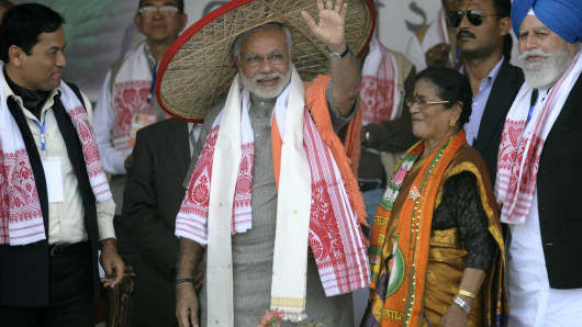 Bharatiya Janata Party prime ministerial candidate Narendra Modi (C) waves to supporters during an election rally.