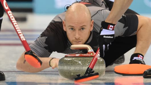 Canada's Ryan Fry throws the stone during the Men's Curling Round Robin Session 7 at the Ice Cube Curling Center during the Sochi Winter Olympics on February 14, 2014.