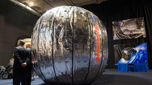 The Bigelow Expandable Activity Module (BEAM) on display during a media briefing at which NASA Deputy Administrator Lori Garver and Bigelow Aerospace founder Robert Bigelow announced that BEAM will join the International Space Station to test expandable space habitat technology.