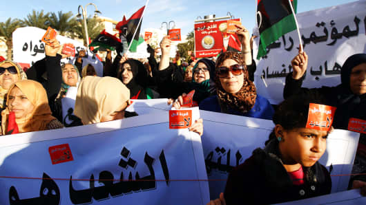 Libyan protesters demonstrate against the extended mandate of the General National Congress, the country's highest political authority, in Benghazi, on February 14, 2014.