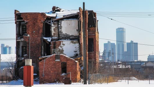 A decaying building and downtown skyline of Detroit, February 2014.