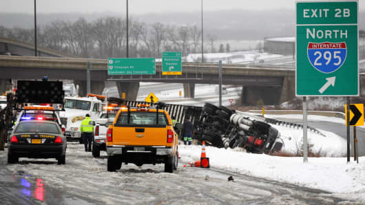 An overturned tractor-trailer on the I-495 in Oxon Hill, Md., on Feb. 13.