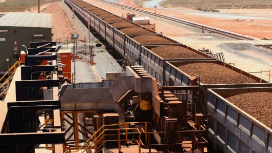 Rail cars laden with iron ore arrive at the receiving facility at Fortescue Metals Group Ltd.'s Herb Elliott Port in Port Hedland in the Pilbara region, Western Australia.