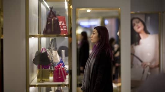 A shopper browses handbags inside a Furla SpA store in Hong Kong, China. Furla, the closely held Italian handbag maker, predicts its China sales will outpace the company's this year as a rising middle class and government austerity drive benefit entry-level luxury goods.