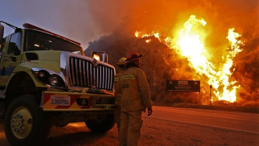 Firefighters monitor the Colby Fire on Highway 39, January 17, 2014, in Azusa, California.