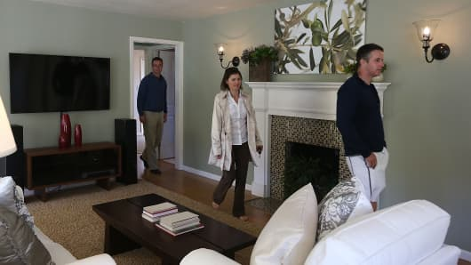 Real estate agents tour a home for sale during an open house in San Anselmo, Calif.