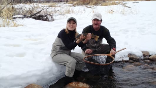 Sporting Ranch Capital's Jay Ellis (r) on one of his PE fund's ranches near Park City, Utah. CNBC's Morgan Brennan holds a brown trout.