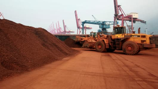 A front loader shifts soil containing rare earth minerals to be loaded in Lianyungang, China, which accounts for about 90 percent of the world's rare earth production.