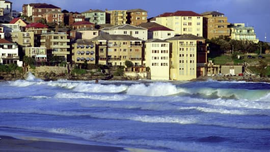 Sunset light on houses by Bondi Beach, Sydney