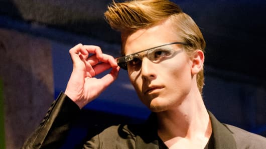 A model shows off Augmate, a digital eyewear platform for Google glass at the Wearable Tech Fashion Show during Social Media Week.