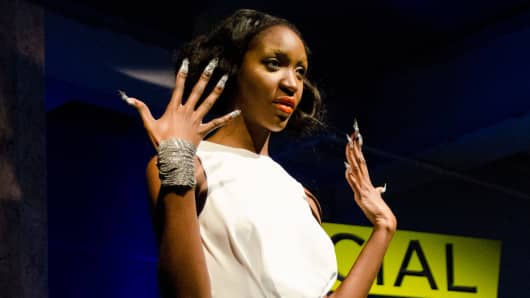 A model shows off her 3-D printed nails at the Wearable Tech Fashion Show during Social Media Week.