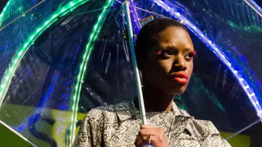 A model sports an LED umbrella at the Wearable Tech Fashion Show during Social Media Week.