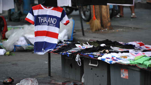 Debris sits on the ground at the scene of a deadly explosion at an anti-government rally on February 23, 2014 in Bangkok.