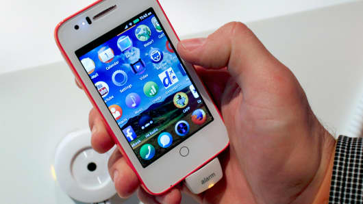 A device with the new Firefox OS is presented at the Mobile World Congress in Barcelona, on February 24, 2014.